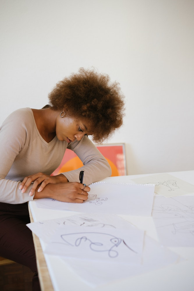 woman drawing, adult coloring, stress relief